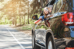 Travel by car family trip together vacation. Travel by car family ride together brother and sister lean out of the window Stock Photo