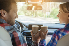 Travel by car family trip together vacation. Travel by car family ride together couple drinking coffee stock image