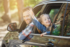 Travel by car family trip together vacation. Travel by car family ride together father and daughter lean out of the window royalty free stock image