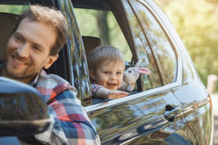 Travel by car family trip together vacation. Travel by car family ride together father and son lean out of the window stock photo