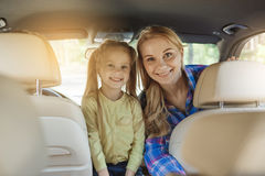 Travel by car family trip together vacation. Travel by car family ride together mother and daughter royalty free stock image