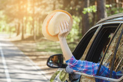 Travel by car family trip together vacation. Travel by car family ride together women holding hat out of the window stock photography