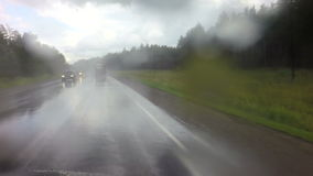 Travel by car in heavy rain on Altai Krai stock video footage