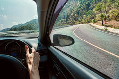 Travel in car. On the mountain road Stock Images
