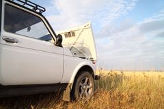 Travel by car. sky and clouds. Breakage of a jeep. travel by car. sky and clouds Stock Photography