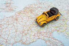 Travel by car. A toy car on Europe map Royalty Free Stock Photography