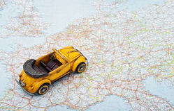 Travel by car. A toy car on the map Royalty Free Stock Photography