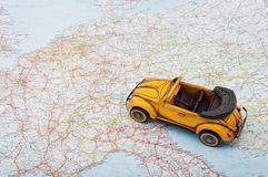 Travel by car. A toy car on the map Royalty Free Stock Photo