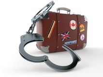 Travel case with handcuffs Royalty Free Stock Photos