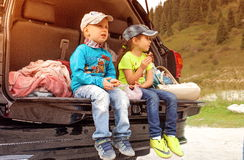 Travel. Children traveling in the mountains by car