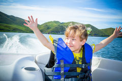 Travel of children on water in the boat. Water walk of children by the boat on the river in a sunny day stock image