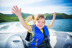 Travel of children on water in the boat Royalty Free Stock Photos