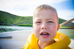 Travel of children on water in the boat Royalty Free Stock Image