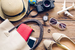 Travel Clothing accessories apparel along with women for the trip.  stock photo