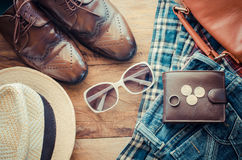 Travel Clothing accessories Apparel along on wooden floor. Royalty Free Stock Photography