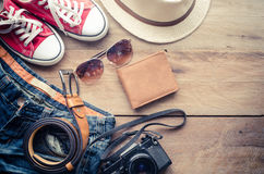 Travel Clothing accessories Apparel along on wooden floor. Travel Clothing accessories Apparel along on wooden floor Royalty Free Stock Images