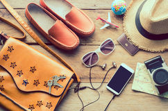 Travel Clothing accessories Apparel along on wooden floor.  Stock Photography