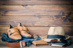 Travel Clothing accessories Apparel along on wooden floor.  Royalty Free Stock Photo