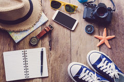 Travel Clothing accessories Apparel along on wooden floor.  Royalty Free Stock Photos