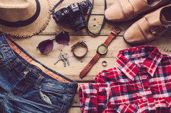 Travel Clothing accessories Apparel along on wooden floor.  Stock Photo