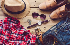 Travel Clothing accessories Apparel along on wooden floor.  Stock Image
