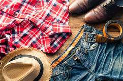 Travel Clothing accessories Apparel along on wooden floor.  Stock Images