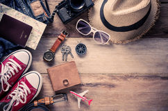 Travel Clothing accessories Apparel on wooden floor. Travel Clothing accessories Apparel on wooden floor Royalty Free Stock Photography