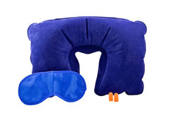 Travel comfort set. A travel comfort set of inflatable neck pillow, a sleeping mask and a pair of earplugs isolated on white background Stock Photos