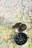 Travel compass and map symbols adventures. The magnetic compass and topographic map. Travel compass and map symbols adventures Stock Photo