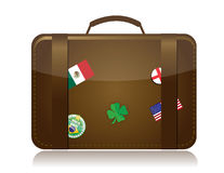 Travel concept. Brown travel luggage with different flags and stickers. Isolated over white Stock Photography