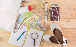 Travel concept with accessory on wooden table Royalty Free Stock Image