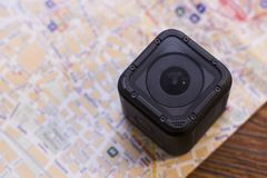 An action and a map. Travel concept. An action camera on a map, close up Royalty Free Stock Photography
