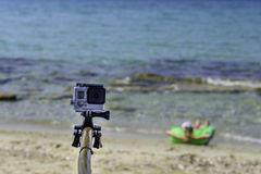 Travel concept - Action camera photography over sea view, with selfie Monopod Stock Photography