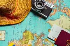 Travel concept background with a retro camera a cup of tea, a ha stock image