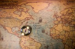 Travel concept background, vintage compas and old earth map.  royalty free stock images