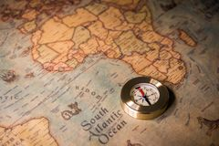 Travel concept background, vintage compas and old earth map.  stock images