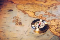 Travel concept background, vintage compas and old earth map.  stock photo