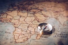 Travel concept background, vintage compas and old earth map.  stock photography