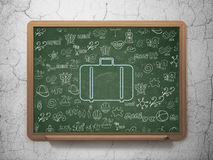 Travel concept: Bag on School Board background Royalty Free Stock Photos