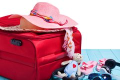 Travel concept with big red travel bag and accessory for trip on Royalty Free Stock Photo