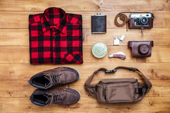 Travel concept boots, shirt, camera, lighter, flask, bag, penkni Royalty Free Stock Image