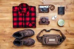 Travel concept boots, shirt, camera, lighter, flask, bag Stock Photo