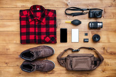 Travel concept boots, shirt, camera, mobilephone, bag, mp3,. Travel concept boots, shirt, camera, mobilephone, mp3, earphones, bag on the desk Royalty Free Stock Photo