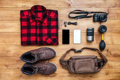 Travel concept boots, shirt, camera, mobilephone, bag, mp3,. Travel concept boots, shirt, camera, mobilephone, mp3, earphones, bag on the desk Royalty Free Stock Photography