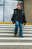 Travel concept of boy on train station steps Stock Image