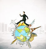 Travel concept. Businessman running on abstract globe with sights on abstract city background. Travel concept Royalty Free Stock Images