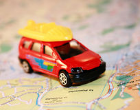 Travel concept - car on a map Stock Images