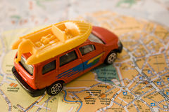 Travel concept - car on a map Stock Photos