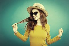 Travel concept - Close up Portrait young beautiful attractive ginger red hair girl with trendy hat and smiling. Duotone royalty free stock photos