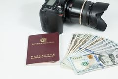 Travel concept, Colombian passport with dollar bills for travel abroad. In neutral background stock photos